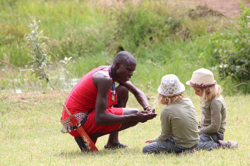 Maasai guide Sam sharing his knowledge with 7 year old twins, Lucie & Bella, at the Mara Bush Houses