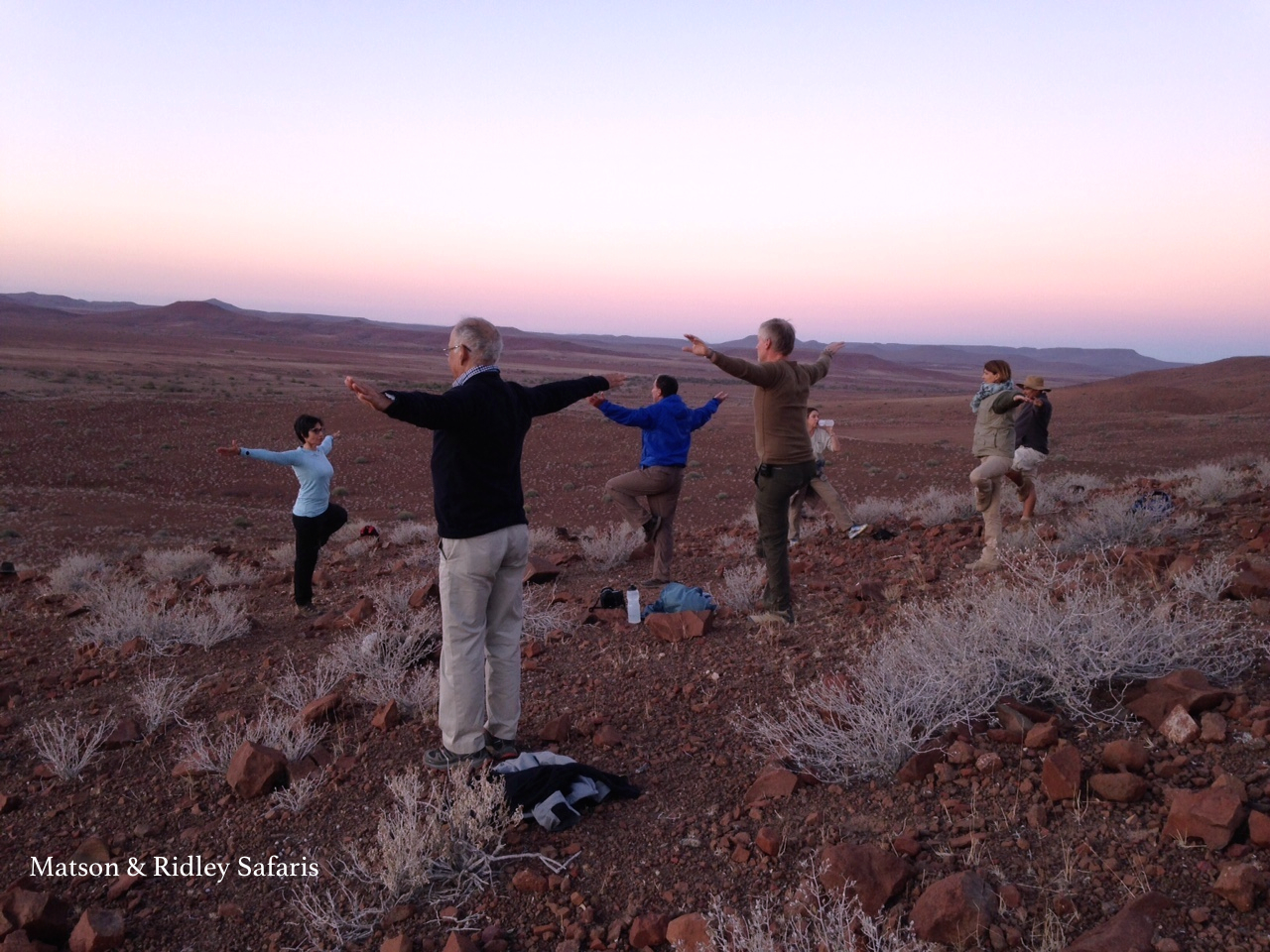 Impromptu yoga session led by Roopa Dewan, one of my guests, as the sun rose over Damaraland