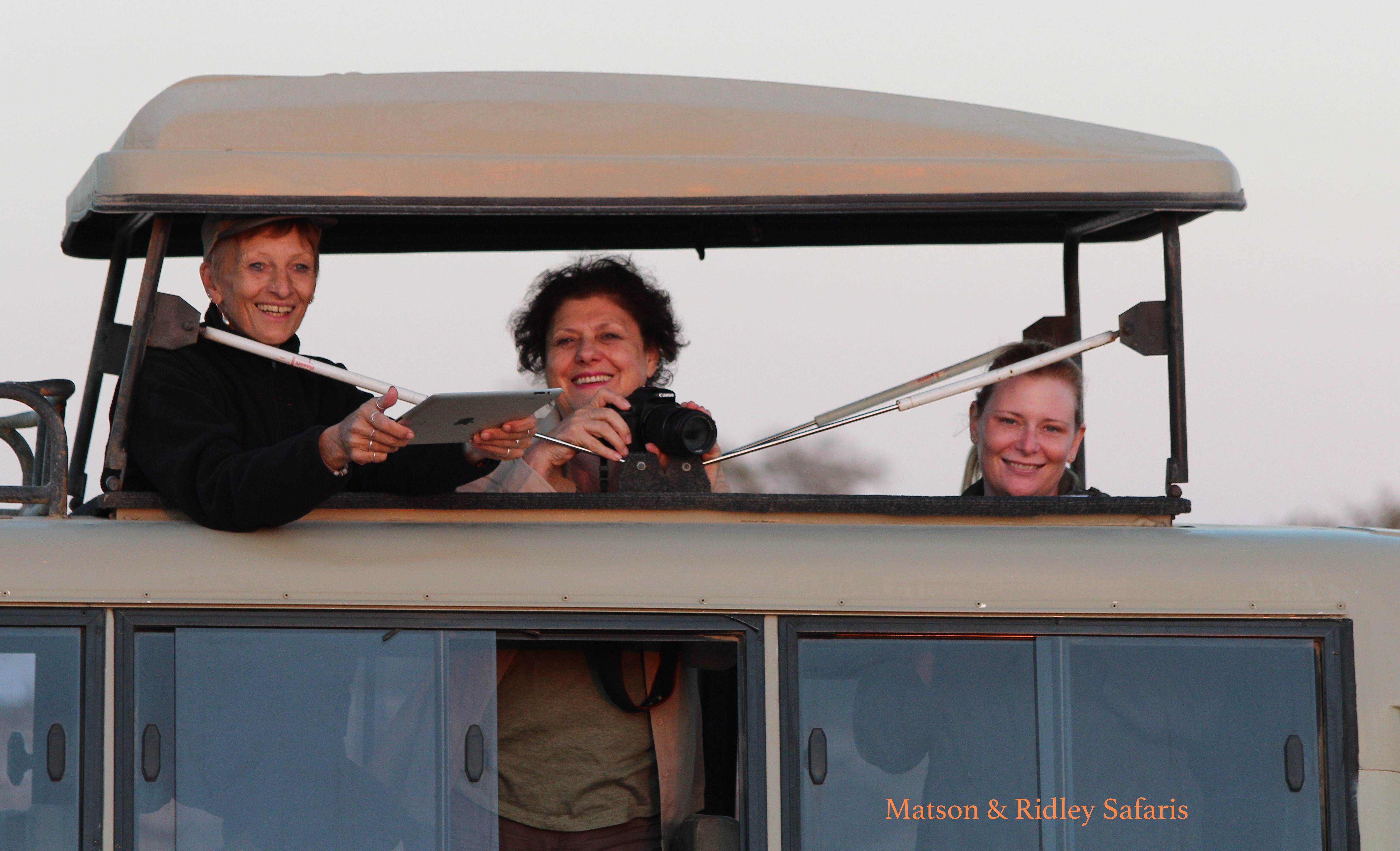 Maggie, Leonie and Joanne watching the sun rise in the Wilderness Safaris land cruiser