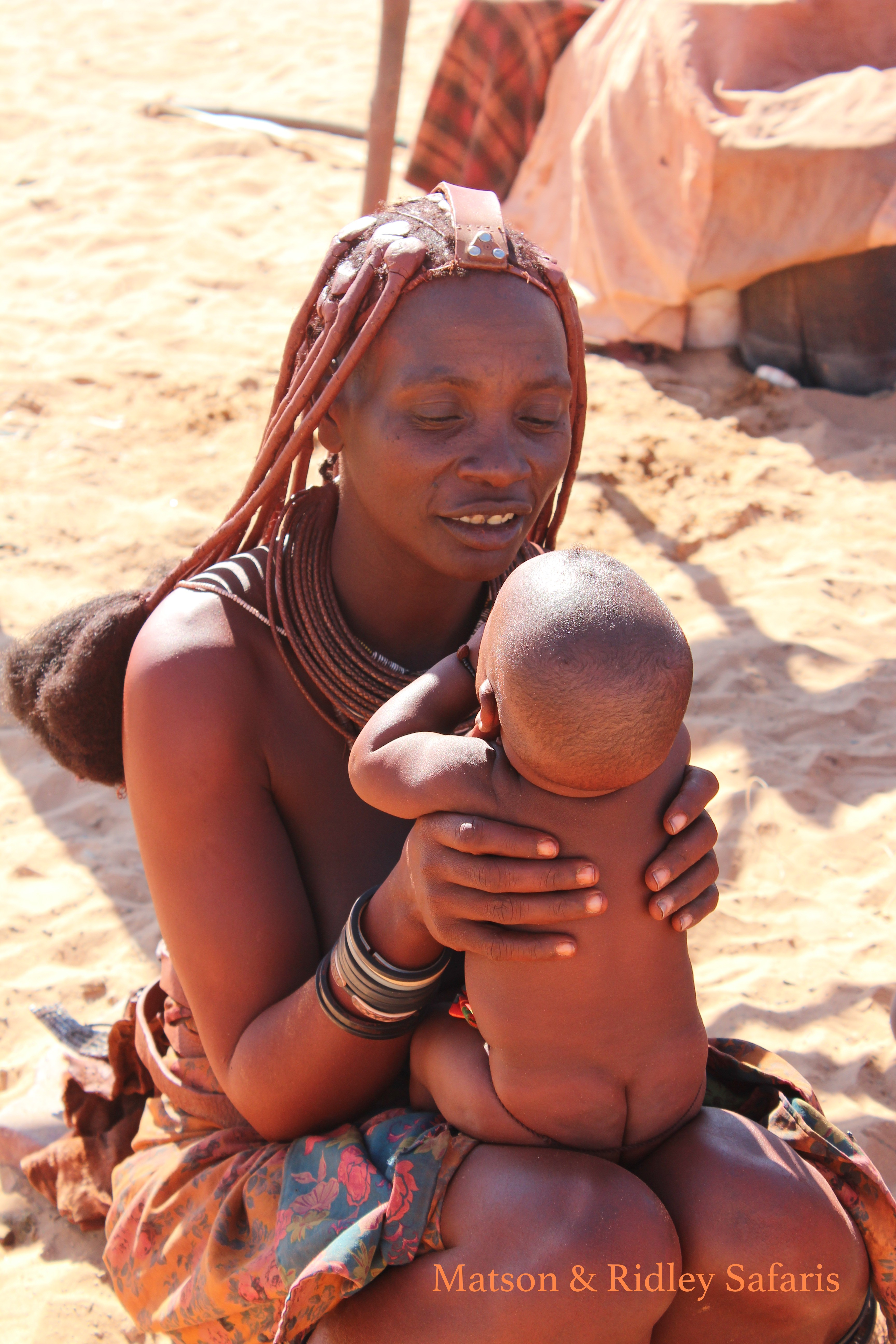 I've always loved watching the Himba women with their small babies.